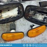 The two-stroke lights were corroded useless, so I replaced the original bulbs with Saab 900 side indicators (with the orange cover removed).