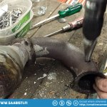 Drilling a hole in the exhaust pipe for the lambda sensor fitting.