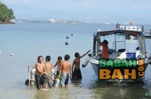 The dive boat of the PADI 5 Star IDC Dive Centre on Gaya island, Kota Kinabalu, Sabah