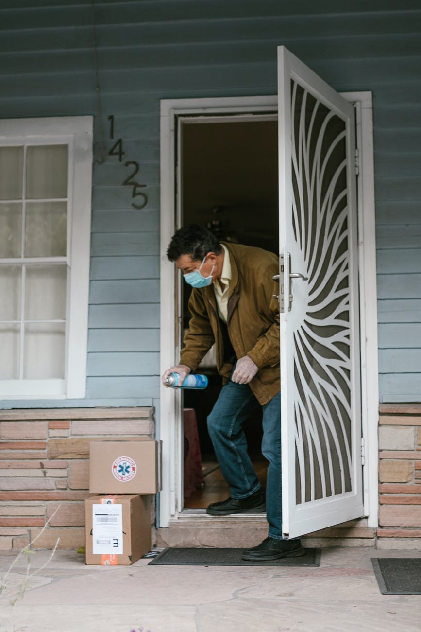 a man disinfecting his packages