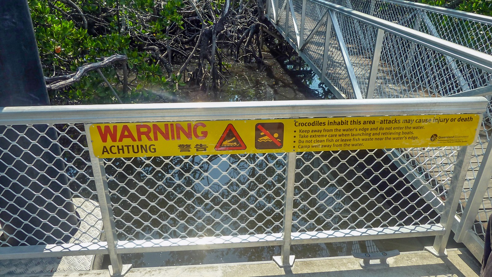 this is a photo of the warning sign at the quay of hinchinbrook island