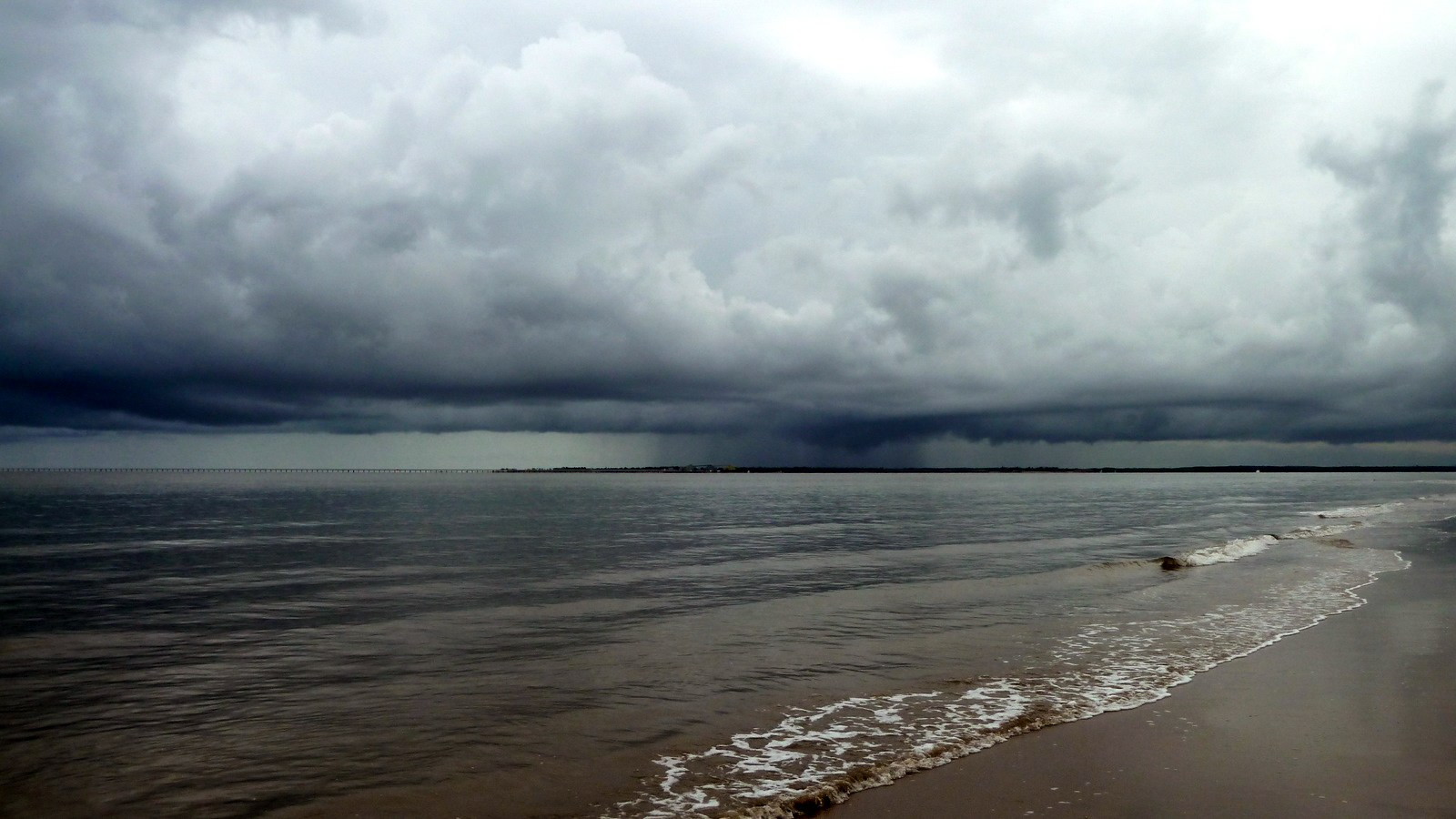 a photo of a storm approaching hinchinbrook island.