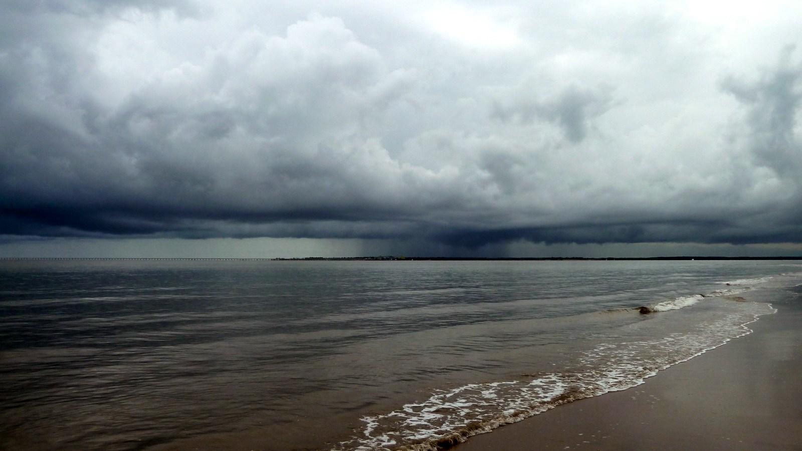 a photo of a storm approaching hinchinbrook island.