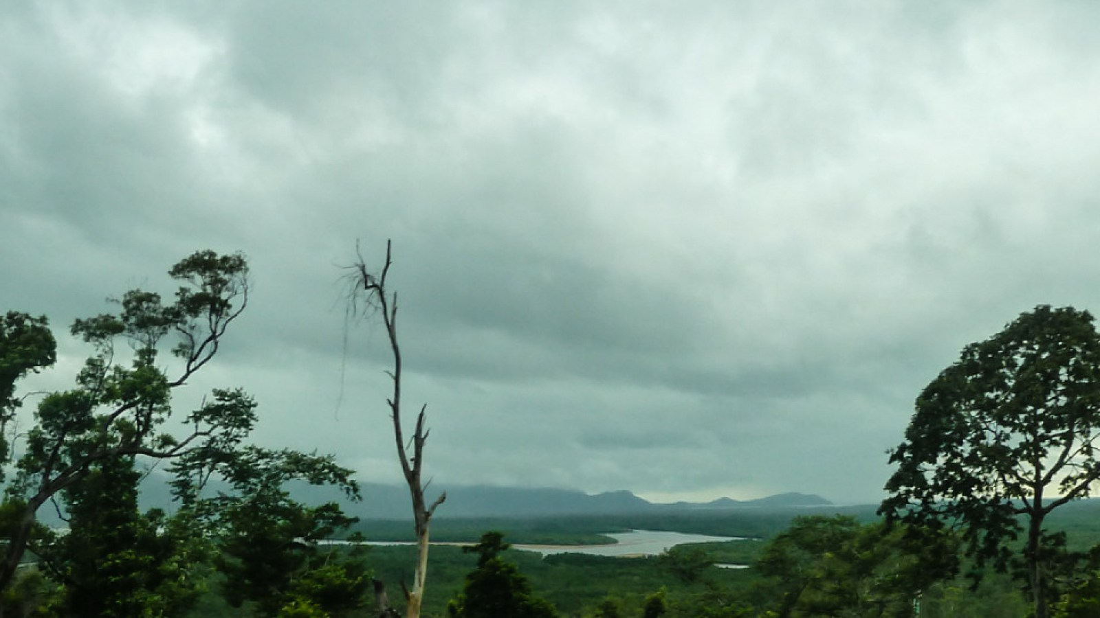 a photo of the west coast of hinchinbrook island as seen from the mainland.