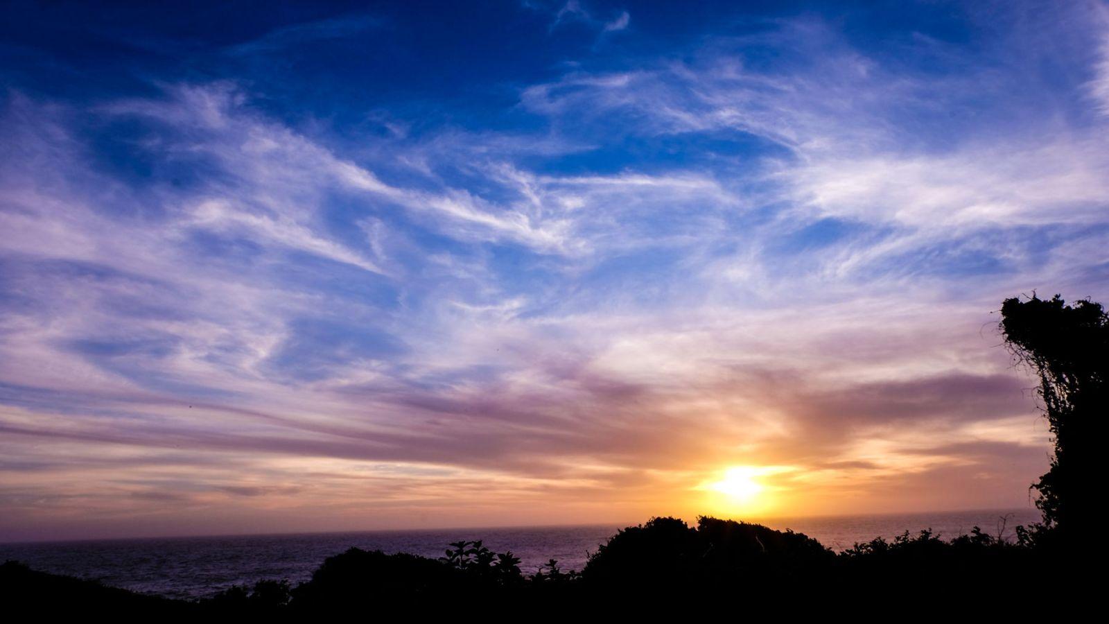 a photo of a sunrise on the coast along the otter trail.