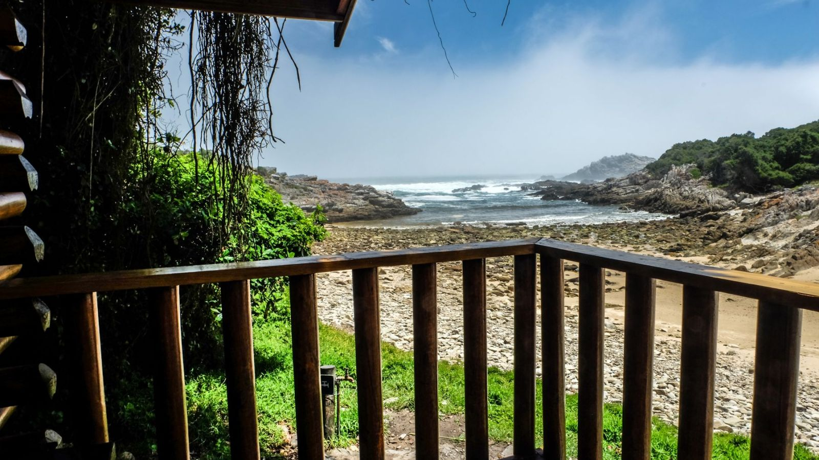 a photo showing the patio of a overnight hut and the beach along the otter trail.