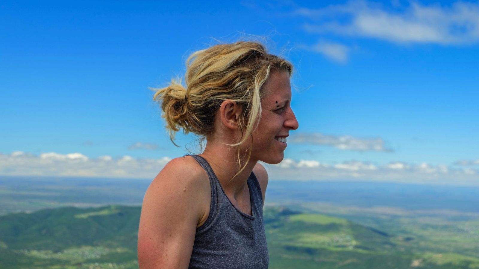 a hiker on the peak of the hogsback with the valley in the background.