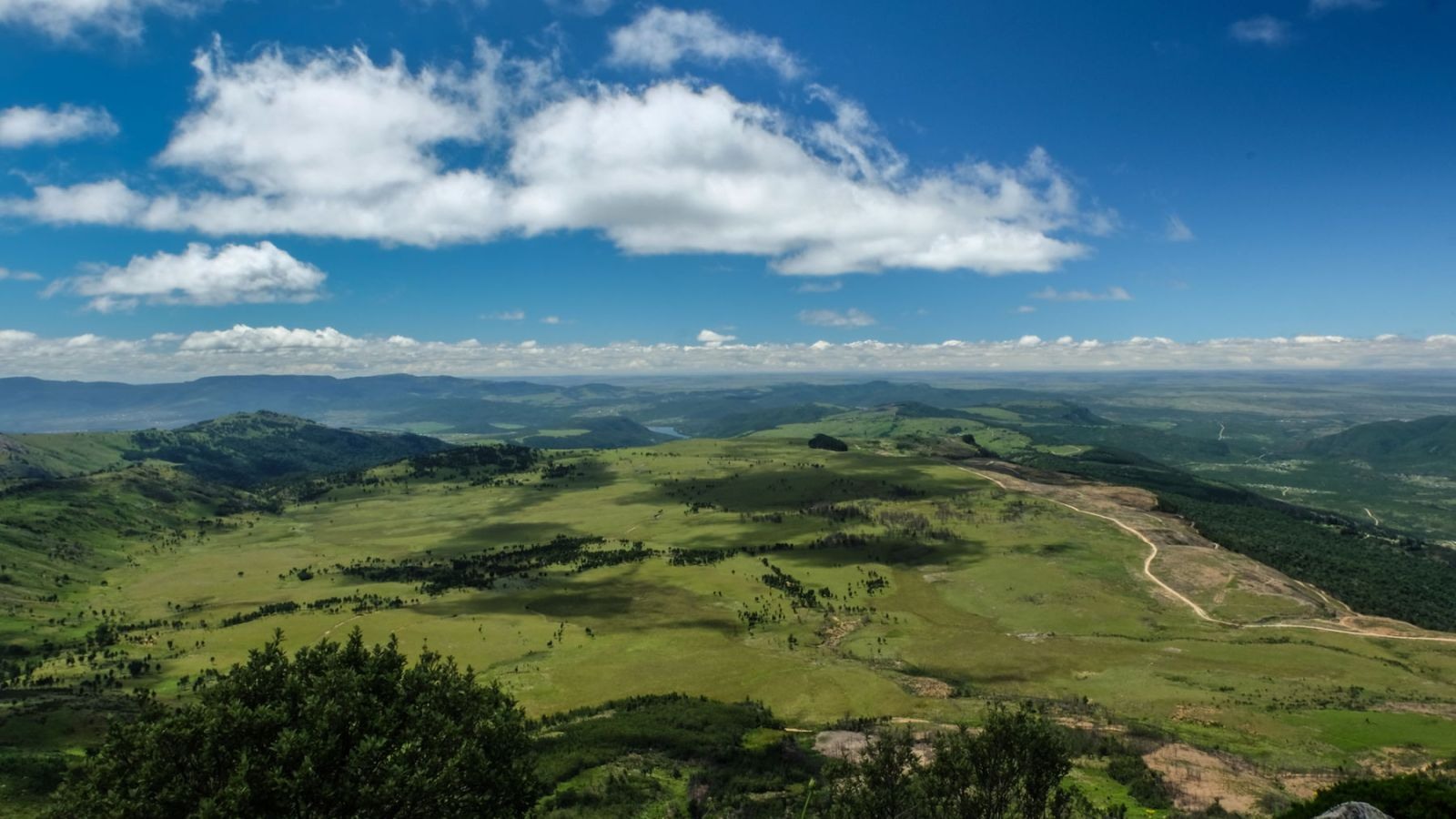 a photo of the valley in the amathole mountains from the peak of the hogsback.