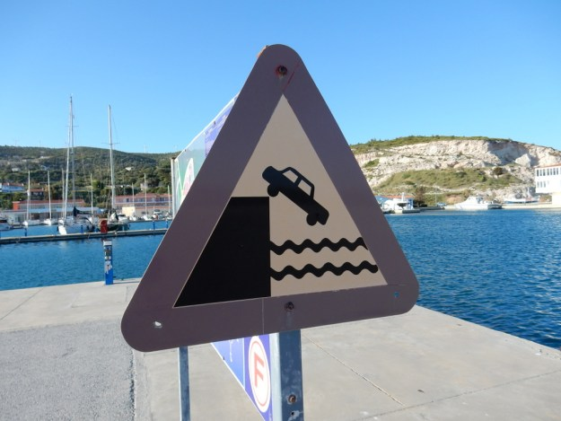 Thanks to this sign I avoided taking the shortcut across the marina in my rental car.