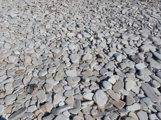 Flat stones make up the beach at St. Georges, Antiparos