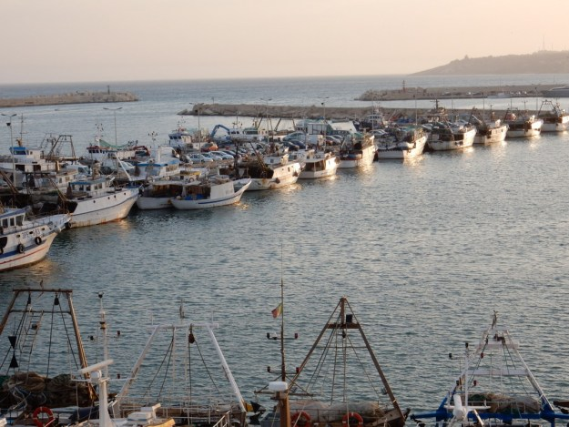 Fishing boats line the docks in Sciacca. Italy