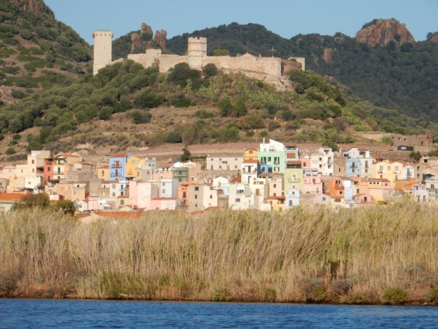 View of the river city of Bosa (Sardinia) as we come up the River Temo in our dinghy. The Malaspina Castle overlooks the city.