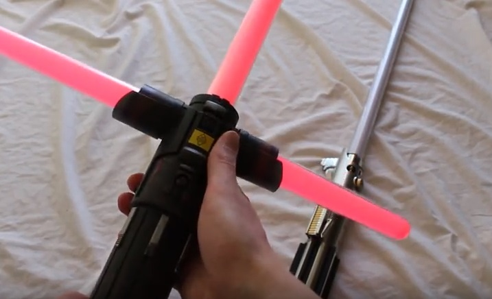 Kylo Ren Force FX lightsaber with a Rey Jedi Training Force FX lightsaber in the background