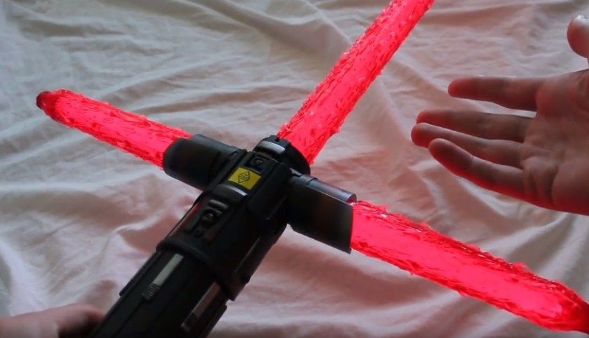 CosplayCovers flame blade covers on a Kylo Ren Force FX lightsaber