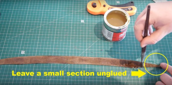diy-lightsaber-tutorial-how-to-apply-a-leather-wrap-to-your-lightsaber-appy-adhesive