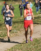 Sophomore Hattie Lukert follows closely behind Hiawatha senior Elizabeth Kettler during the 3A Regional Cross Country meet on Saturday, October 20, in Sabetha. Lukert finished the race in first place.
