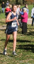 Sophomore Kenzie Meyer maintains her pace during the 3A Regional Cross Country meet on Saturday, October 20, in Sabetha.