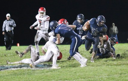 Senior Ryan Stapleton seals the edge, which allows senior running back Joe Gruber to cut upfield on Friday, October 12.
