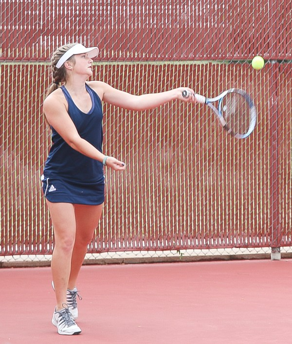 Senior doubles player Brooklyn Bauman hits the ball back across the net during the 3A Tennis Regionals on Friday, October 5, in Hesston.