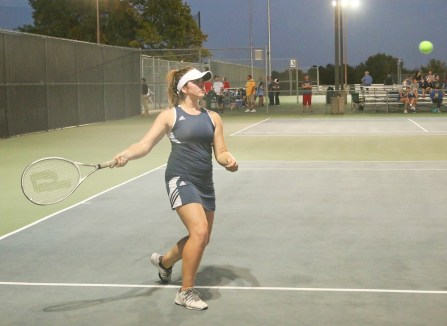 Junior doubles player Kinsey Menold prepares to send the ball back to her opponents on Friday, October 5, in Hesston at the 3A Tennis Regional competition.
