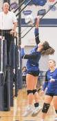 Sophomore Melinna Schumann goes up for the middle hit during league action versus Hiawatha on Tuesday, October 16.