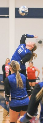 Junior Payton Michael jumps up for the backside hit during the Sabetha-Hiawatha contest on Tuesday, October 16.