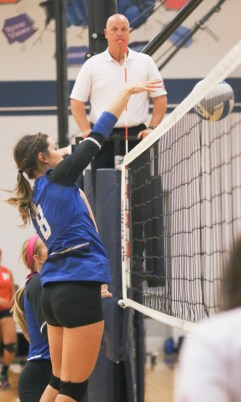 Senior Shayna Strahm knocks back the miscue from Hiawatha's side, during action with the Red Hawks on Tuesday, October 16.