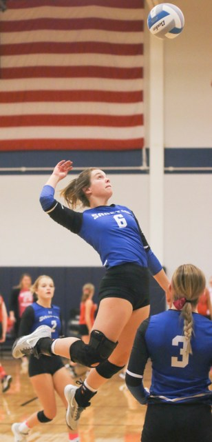 Junior Mariah Russell goes up for the middle hit during the Sabetha-Hiawatha volleyball match-up on Tuesday, October 16.