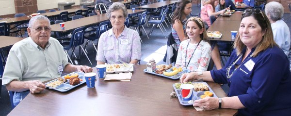 Sabetha Middle School student Demelia Funk enjoys lunch with her grandparents during the eighth grade Grandparents Day on Thursday, September 27. Picture are (L-R) Bob Brenzikofer, Ann Brenzikofer, Demelia Funk and Kathy Inlow.