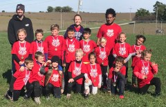 The first- and second-grade Red Lightning soccer team wins the league tournament championship on Saturday, October 13. The team went 3-1 in regular season play, and 3-0 in tournament play. Pictured are FRONT ROW (L-R) Harrison Menold, Alden Deters, Grant Stapleton, Evva Deters, Maggie Anson, Taylor Georg and Dezirae Reed; SECOND ROW (L-R) Cecelia Becker, Hudson Scoby, Brad Hinton, Wellington Hooper, Reid Bidwell, Paycen Schremmer, Sarah Anson and Erica Hurts; BACK ROW (L-R) Coaches Rodney Deters, Amber Deters and Wes Hurts. Not pictured is Oliver Geyer.