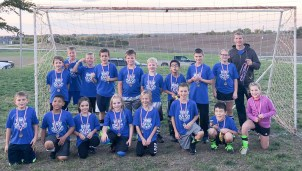 Members of the third- and fourth- grade blue soccer team are FRONT ROW (L-R) Daniel Garber, Kavon Epple, Myley Wasinger, Jessa Kibbe, Kiaya Beyer, Isaac Wikle, Simon Livengood and Haidyn Jackman; BACK ROW (L-R) Jayce Rebant, Kyson Wertenberger, Micah Lang, Colby Stoller, Jayton Meyer, Calvin Jahn, Zayden Morales Whitebird, Kirt Wertenberger, Sophia Haverkamp and Coach Cale Lang. Not pictured is Coach Jobi Wertenberger. The team went 2-1 in the tournament, taking third place. In the regular season, the team's record was 1-3.