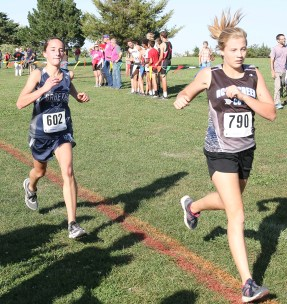 Freshman Jadyn Dorn closes in on Brooklyn Goehring of Rock Creek as they cross the finish line on Thursday, September 27, at Horton.
