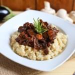 Quinoa con ragú de champiñones y berenjena