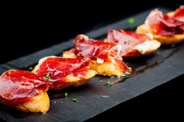 Typical spanish snack of cured ham and bread ready to eat