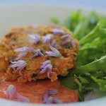 Crispy Crab Cake with Roasted Red Pepper Sauce and Chive Blossoms