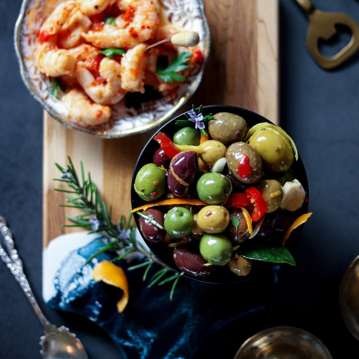 Grazing board with warm marinated olives and spicy Sardo shrimp