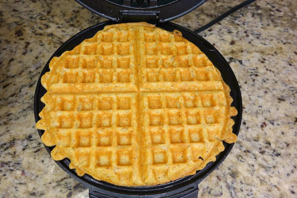 homemade Paleo pumpkin waffles freshly cooked on a waffle iron