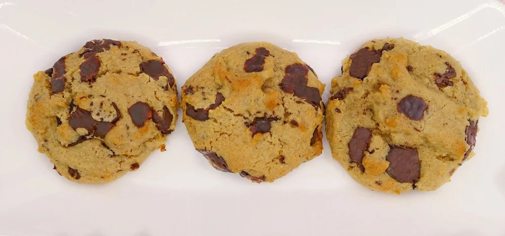 three homemade soft and chewy Paleo chocolate chip cookies on a white plate