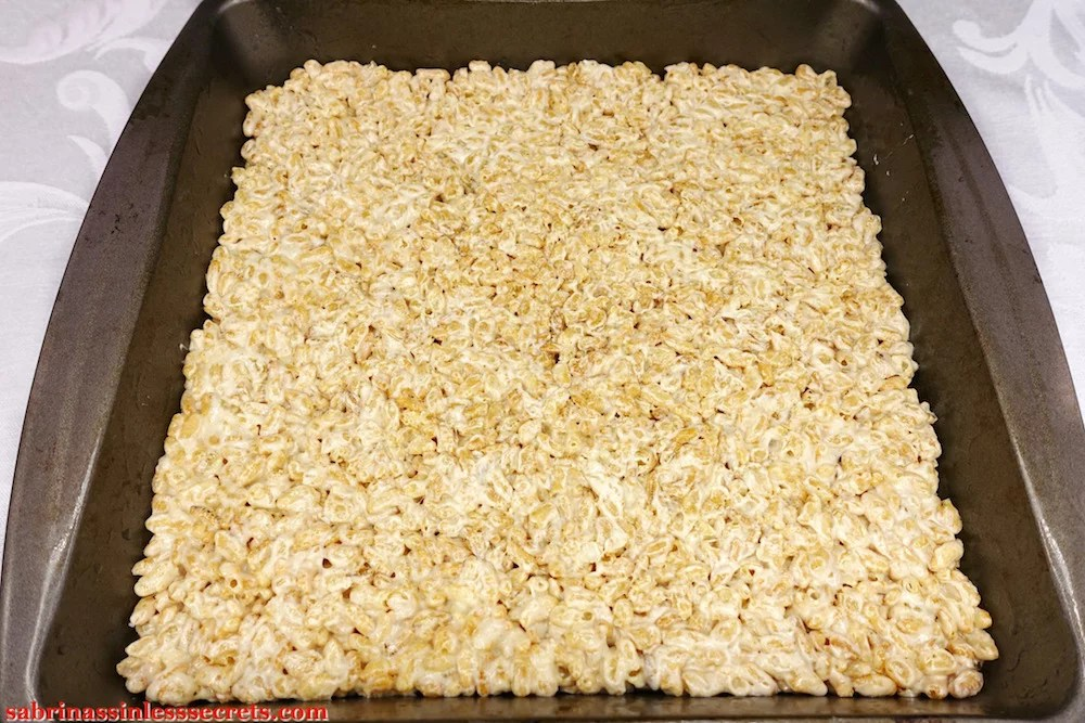 Healthy Brown Rice Crispy Treats (or Bites) after being pressed down evenly into a 9x9-inch pan