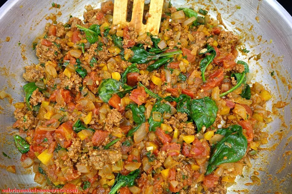 Grass-fed ground beef, tomatoes, onion, bell pepper, jalepeno pepper, spinach, parsley, and spices cooked in a stainless steel skillet