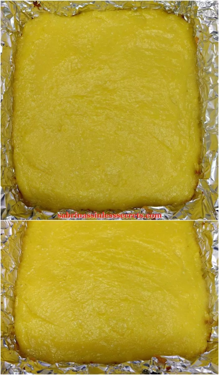 "The baked lemon layer of Paleo Lemon Bars with a Shortbread Crust spread over the crust in a 8""x8"" aluminum foil baking dish"