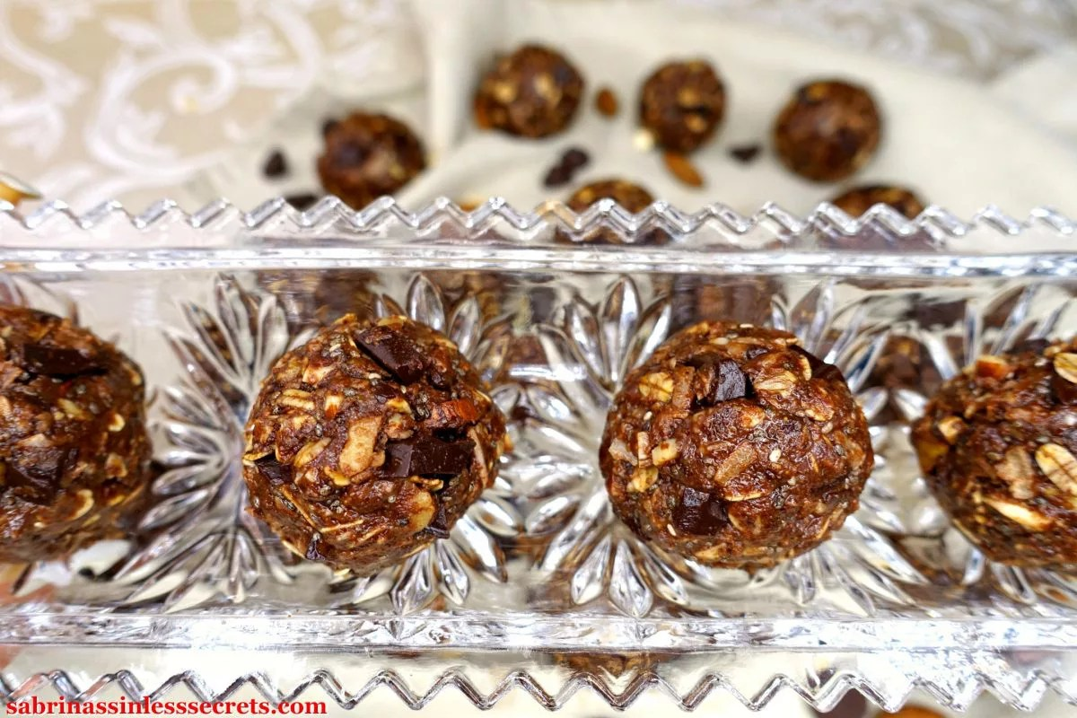 Gluten-Free and Vegan No-Bake Chocolate Chunk Almond Coconut Energy Balls in a crystal tray