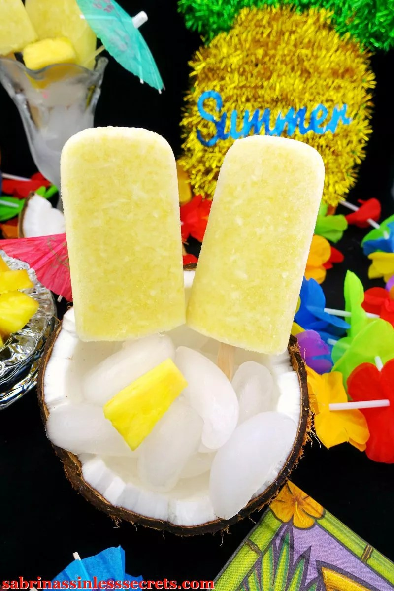 These cooling, refreshing, sweet, and tropical Paleo & Vegan Piña Colada Popsicles are the best way to combat the summer heat. There's no nasty refined sugar to sweeten these; just a little bit of maple syrup and pineapple. You won't miss a thing since these are way better! You won't believe these delicious popsicles are Paleo, vegan, gluten-free, refined sugar-free, dairy-free, and clean-eating certified!