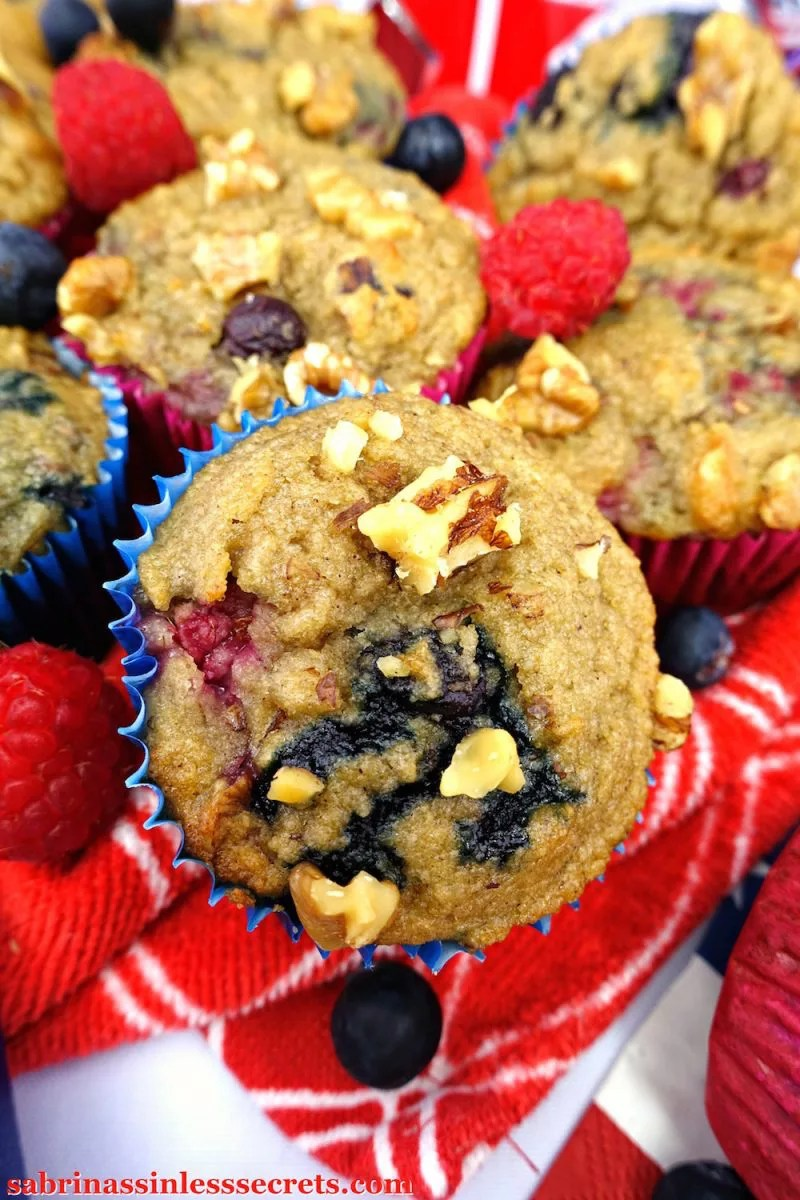 Fluffy, soft, and moist Paleo Blueberry Raspberry Banana Walnut Muffins that are easy to make, gluten-free, dairy-free, refined sugar-free, contain only ONE tablespoon of oil, and are completely sinless!