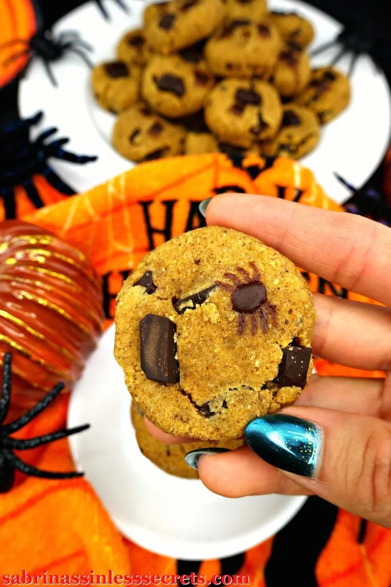 """You won't be able to deny the soft, chewy, pumpkiny, dark chocolatey, sweet yumminess of these Paleo Pumpkin Chocolate Chunk Spider Cookies! I know """"spider"""" is in the name, but the only spiders you'll be eating are the chocolate ones, dormant on Paleo, gluten-free, dairy-free, refined sugar-free, oil-free, grain-free, and clean eating cookies!"""