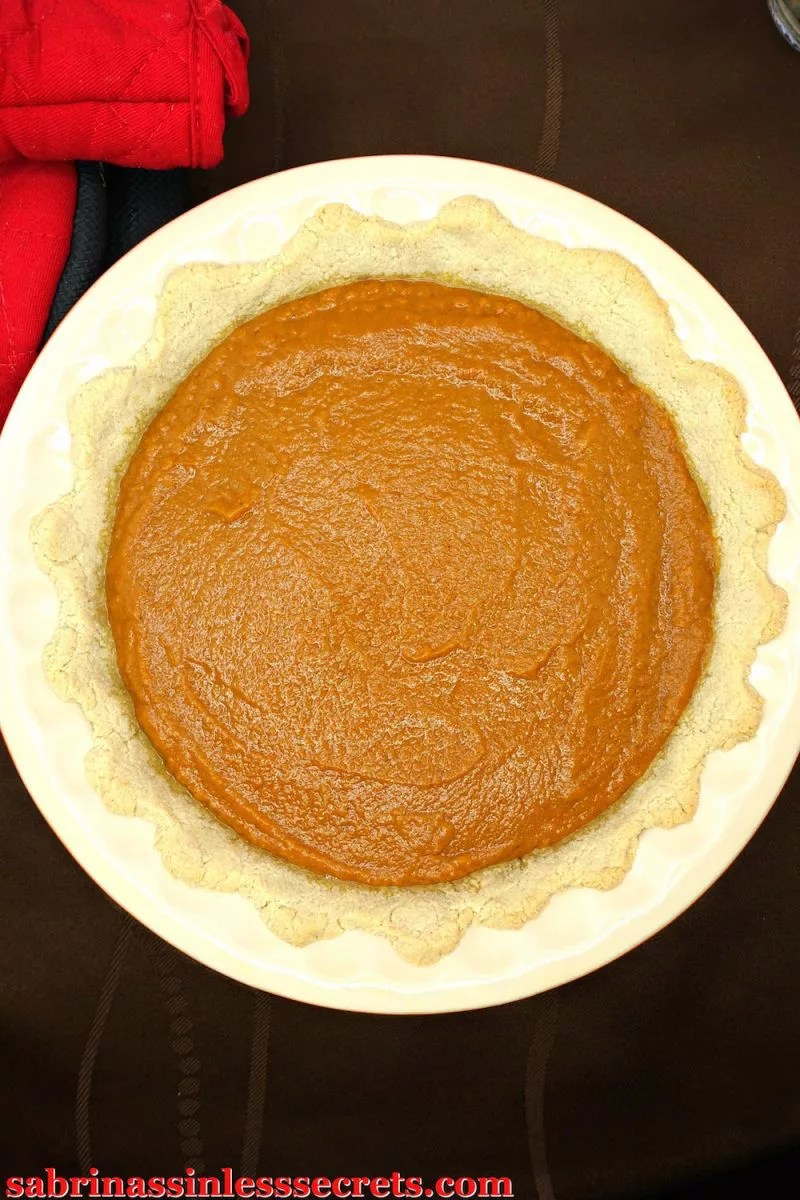 Closep of pumpkin pie filling in crust
