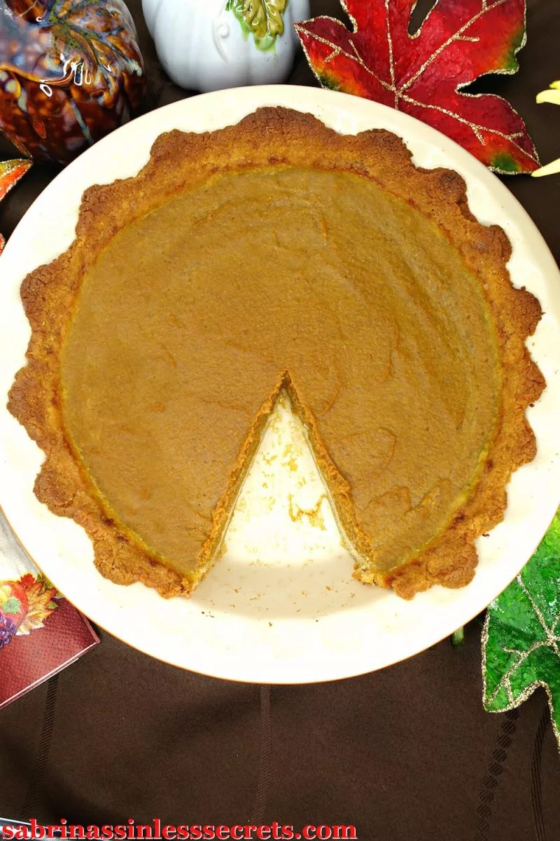 Traditional paleo pumpkin pie with slice taken out of it