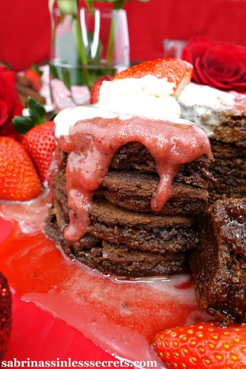 Not only are these fluffy pancakes overflowing with chocolate flavor, but they're also joined by a quick, easy, and tasty strawberry sauce and whipped cream topping! These Paleo Chocolate Pancakes with Strawberry Sauce and Whipped Cream are a dream come true, and will turn any Valentine's Day breakfast into an extravagant, loving, and sinlessly delicious one! The sinful taste will have you doubting that they're Paleo, gluten-free, dairy-free, refined sugar-free, oil-free, and clean-eating!