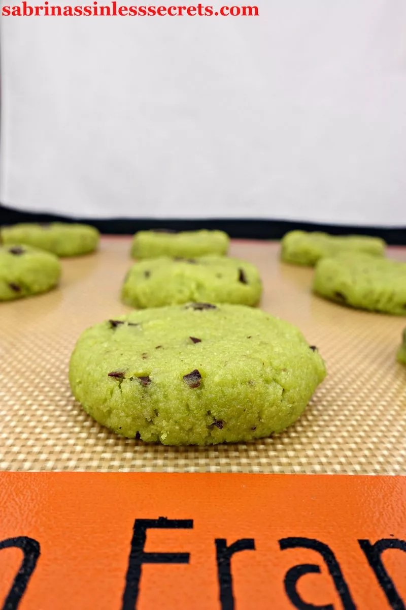 These Paleo Mint Chocolate Chip Cookies are like little green fluffy clouds of mint! The morsels of dark chocolate complete these cookies, offering a delicious combo! Besides being Paleo, gluten-free, dairy-free, refined sugar-free, and clean-eating, they're naturally dyed with two secret healthy ingredients!