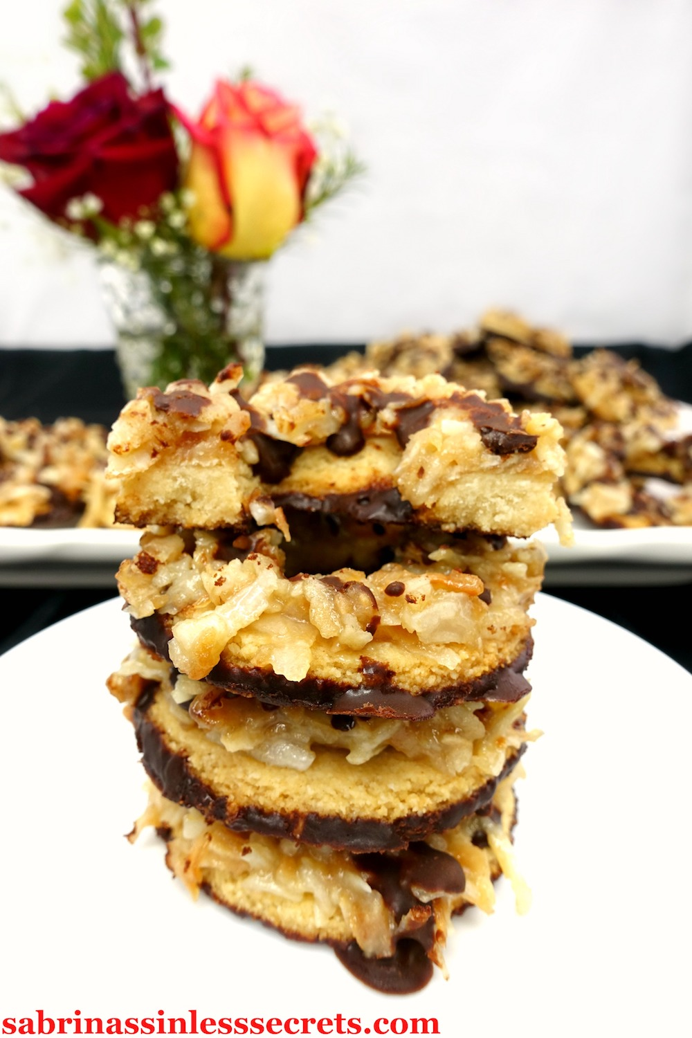 These Paleo and Vegan Samoa Cookies are just like the boxed Girl Scout ones! Thick, gooey caramel merges with toasted coconut to put an irresistible coating over crisp, shortbread cookies! The homemade dark chocolate on the bottoms and a drizzle on top makes these ring-shaped wonders even more of a delight. You won't believe they're Paleo, vegan, dairy-free, refined sugar-free, gluten-free, grain-free, and clean-eating!
